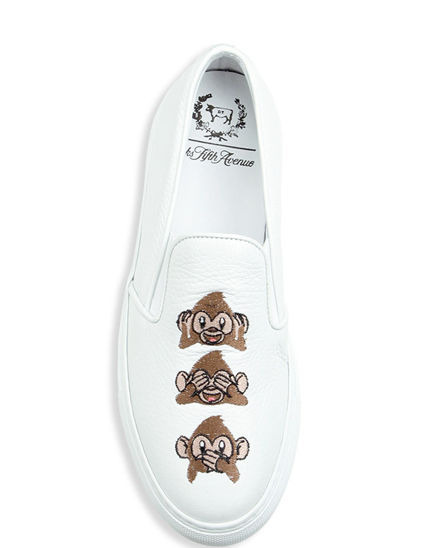 Del Toro-designed leather skate sneakers with monkey emoji designs.